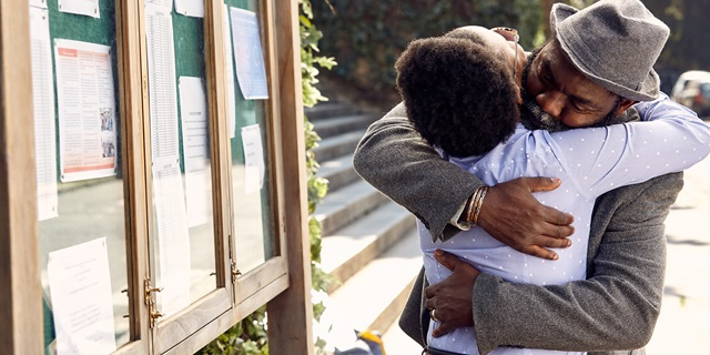 DirectAxis_TVC Education Brand campaign_Father and daughter hugging each other next to university results board